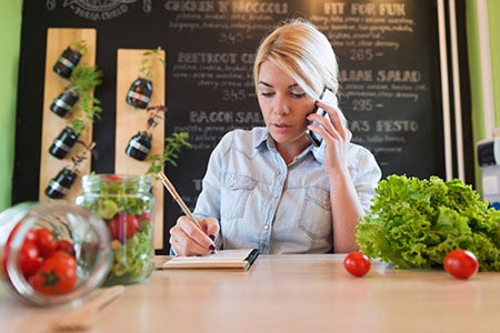4-25 Woman Managing Her Restaurant Franchise