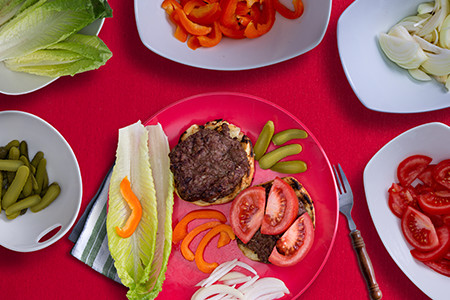 All types of burger toppings on plate